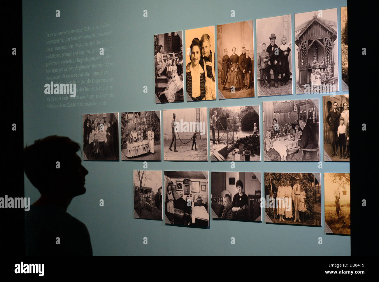 A man looks at a photo wall at the exhibition 'Childhood pictures - Everyday photography in Brandenburg since - Stock Image
