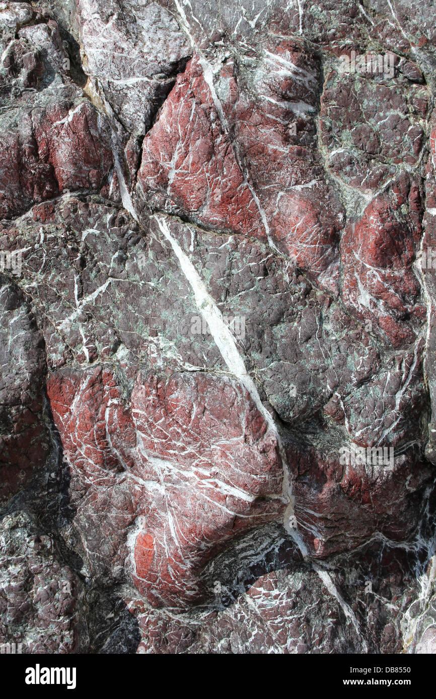 Red Jasper On Llanddwyn Island - Stock Image