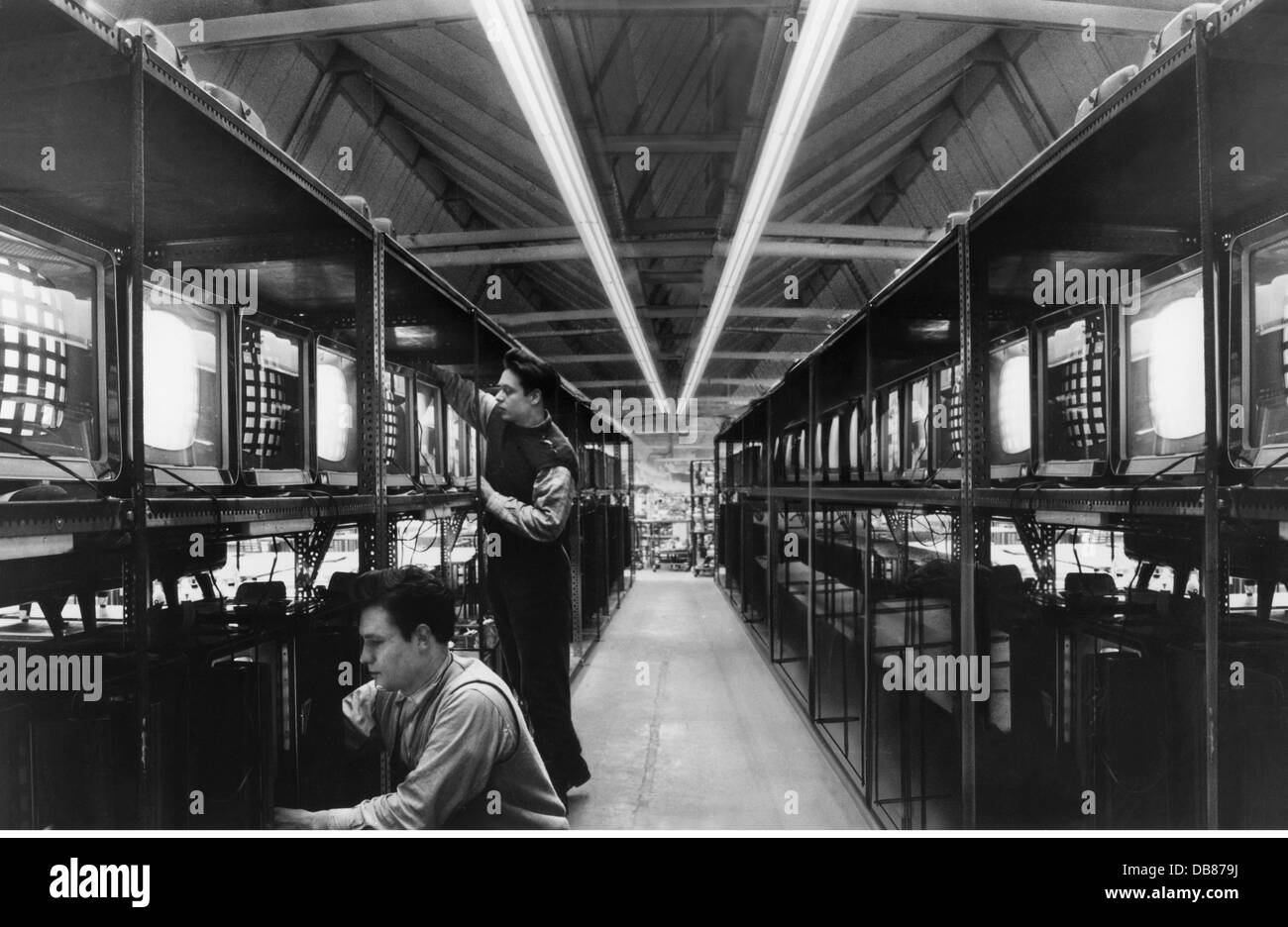 industry, radio and television sets, Telefunken, plant Hanover, televison set controlling line during the night - Stock Image