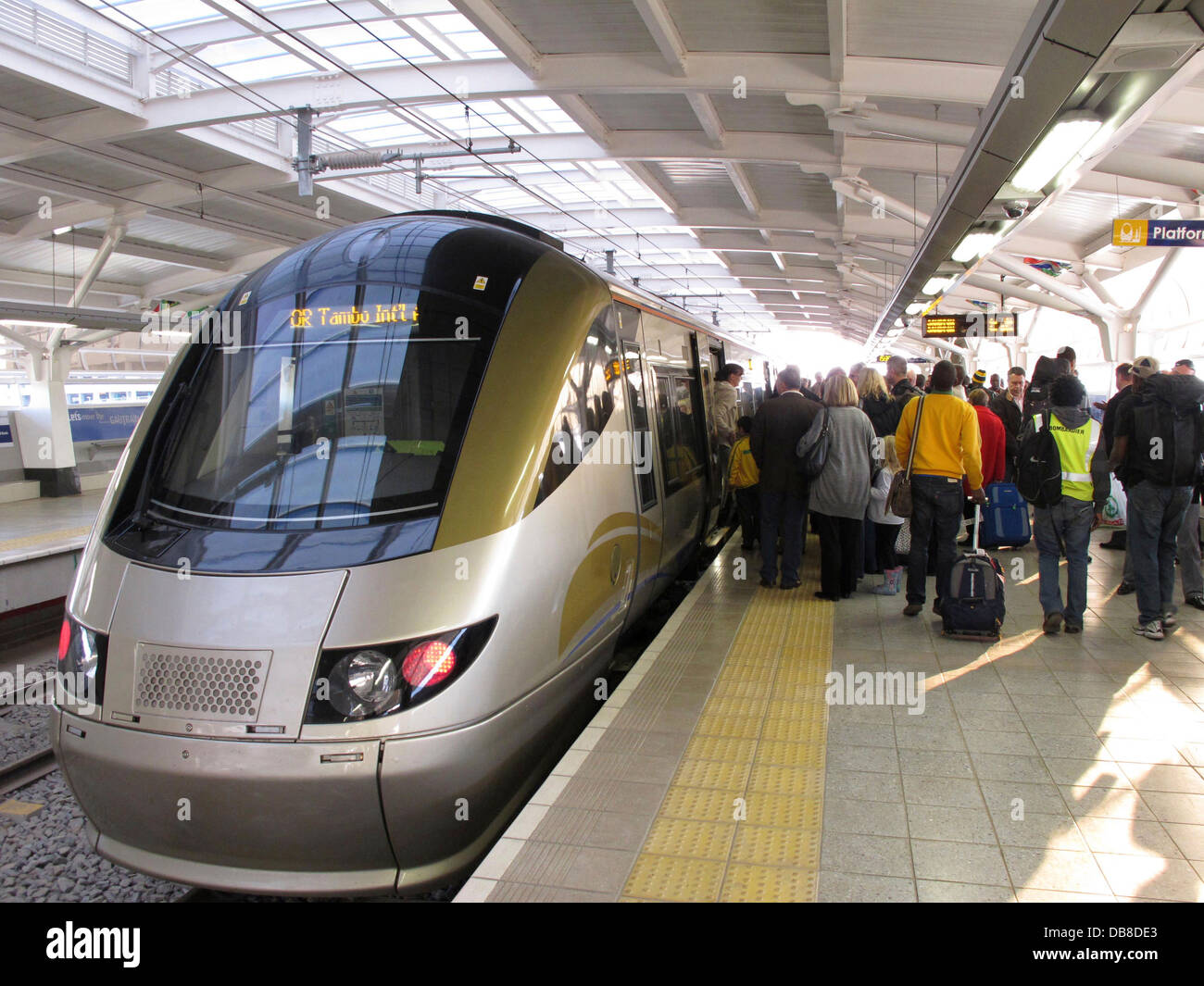 passengers boarding the Gautrain at Oliver Tambo International Airport in Johannesburg - Stock Image