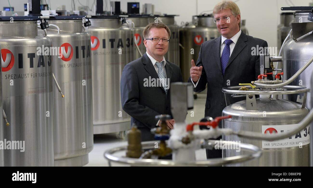 CEO of VITA34 Andre Gerth (R) and CFOJoerg Ulbrich talks in the new Umbilical cord storage bank facility - Stock Image