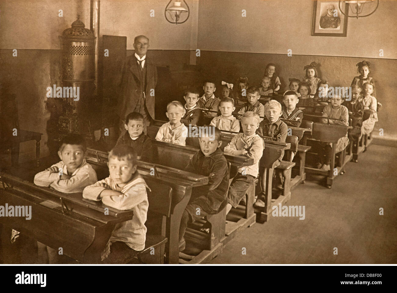 pedagogy, school, class, boys and girls sitting separate, picture of the last Bavarian King Ludwig II in the background, - Stock Image