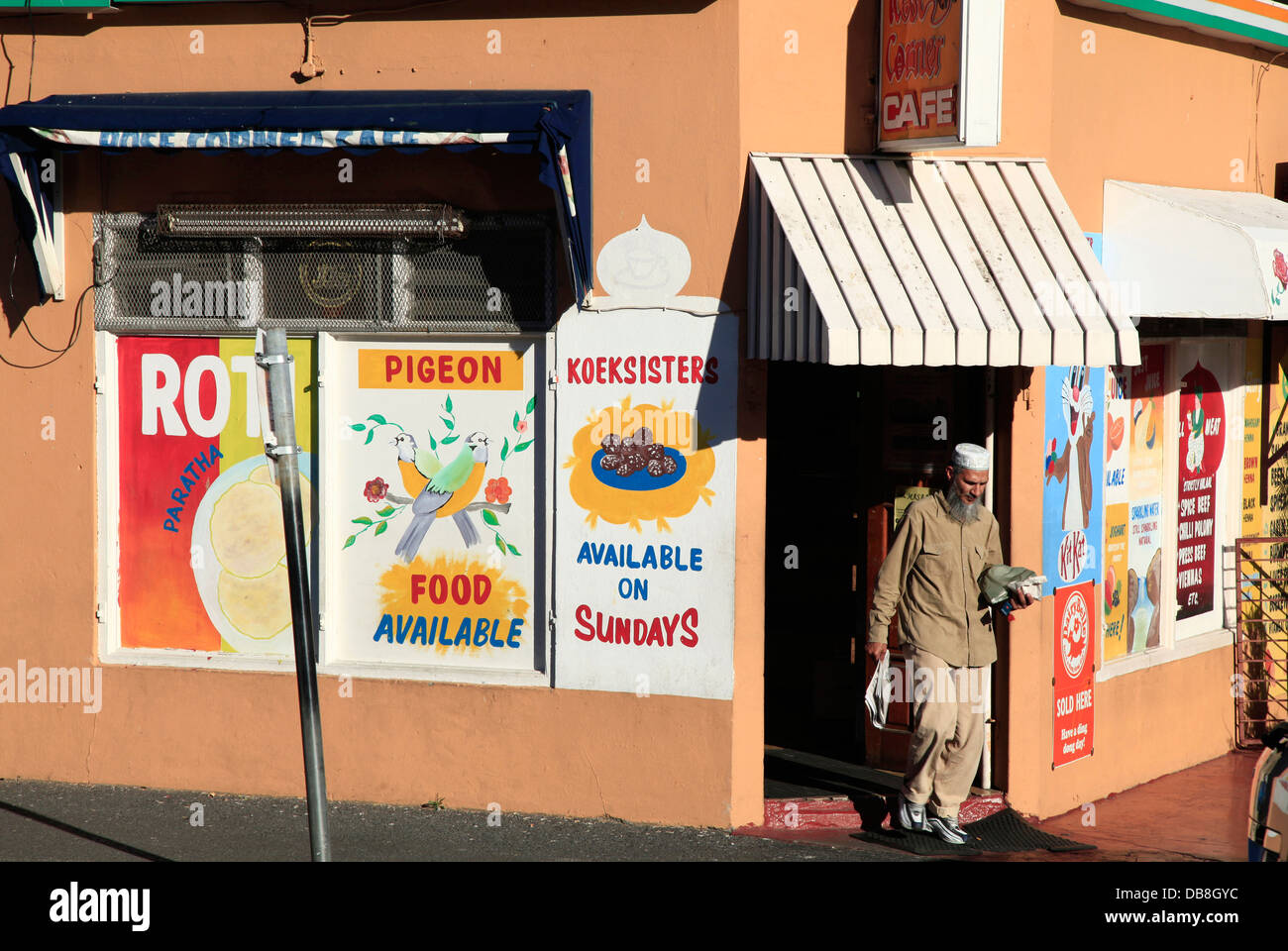 Moslem nan walking out of a cafe in Bo-Kaap in Cape Town - Stock Image