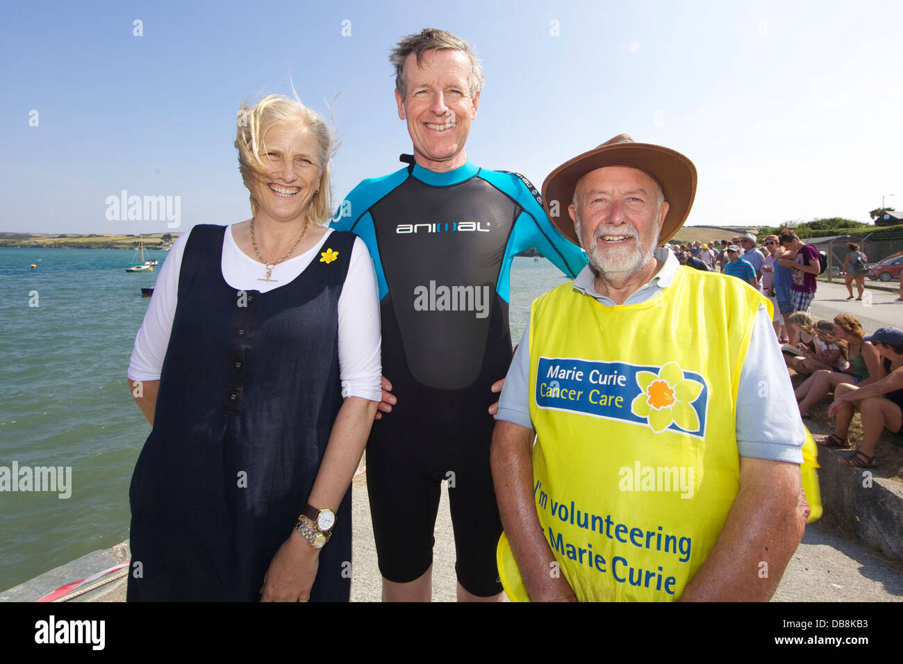 Taking part in this year's Marie Curie Padstow to Rock charity swim are Lord Lieutenant Colonel Edward and Lady - Stock Image