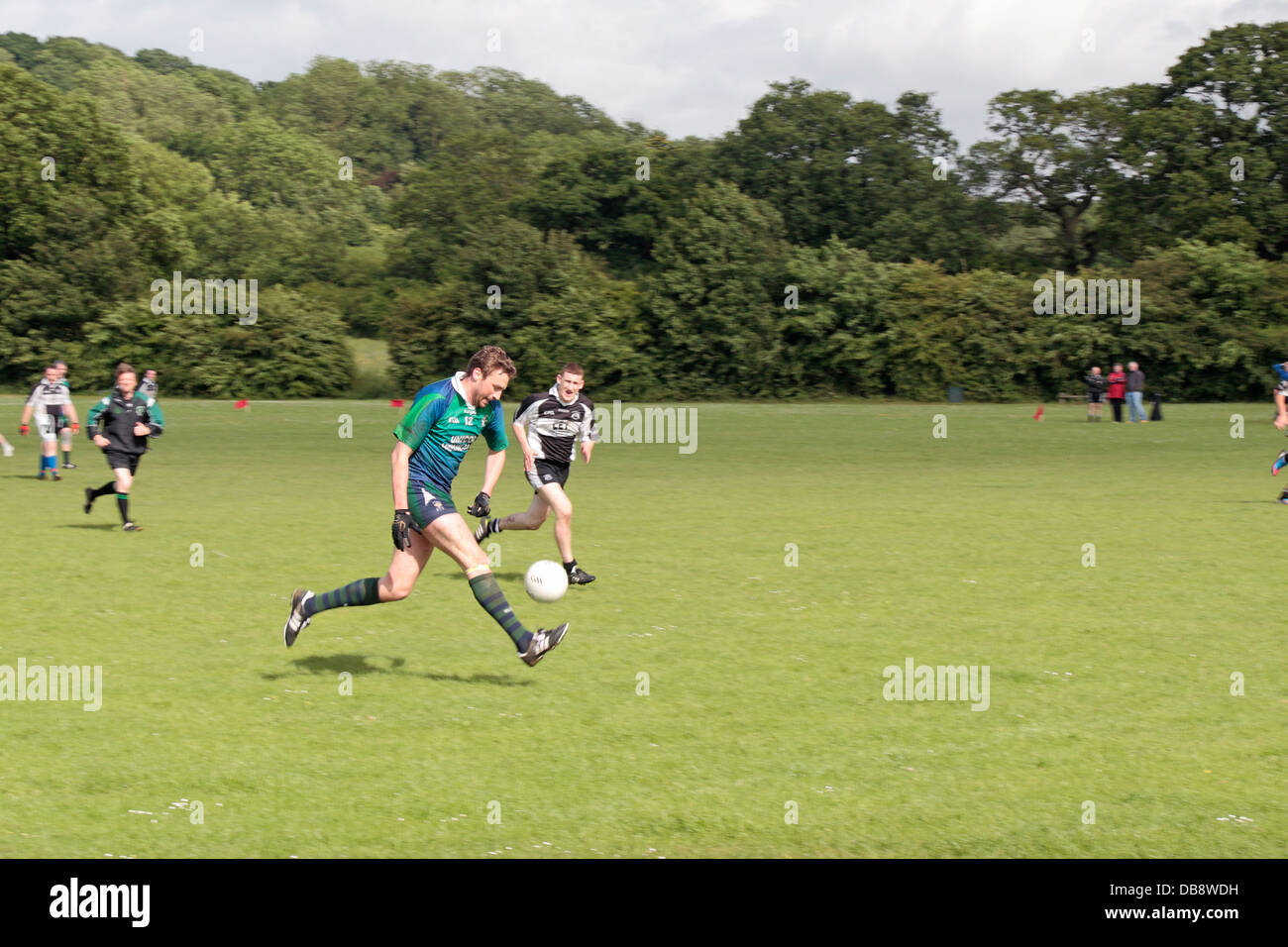 Men playing Gaelic sports (Gaelic football) being played in England at the Tir Chonaill Gaels club in Greenford, Stock Photo