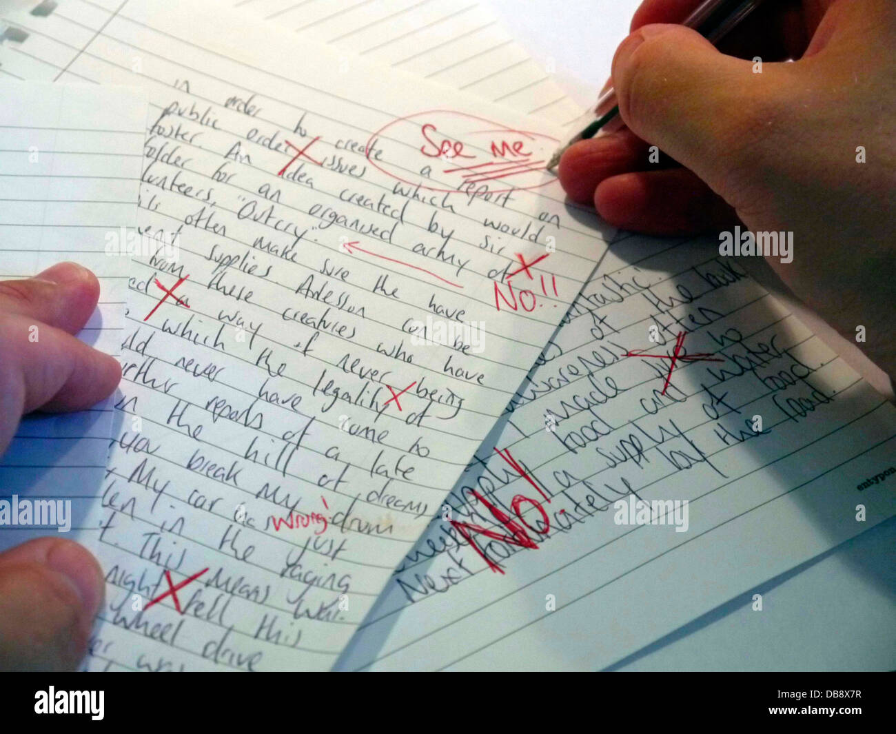 A Teacher Marking A Poor Exam Paper Stock Photo 58588539