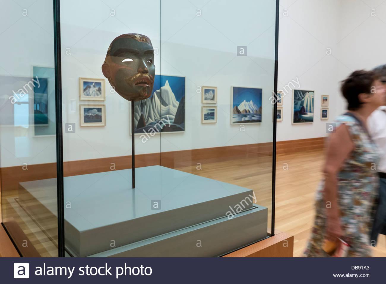 Aboriginal mask also paintings by Lawren Harris on display in renovated Art Gallery of Ontario in Toronto Ontario - Stock Image