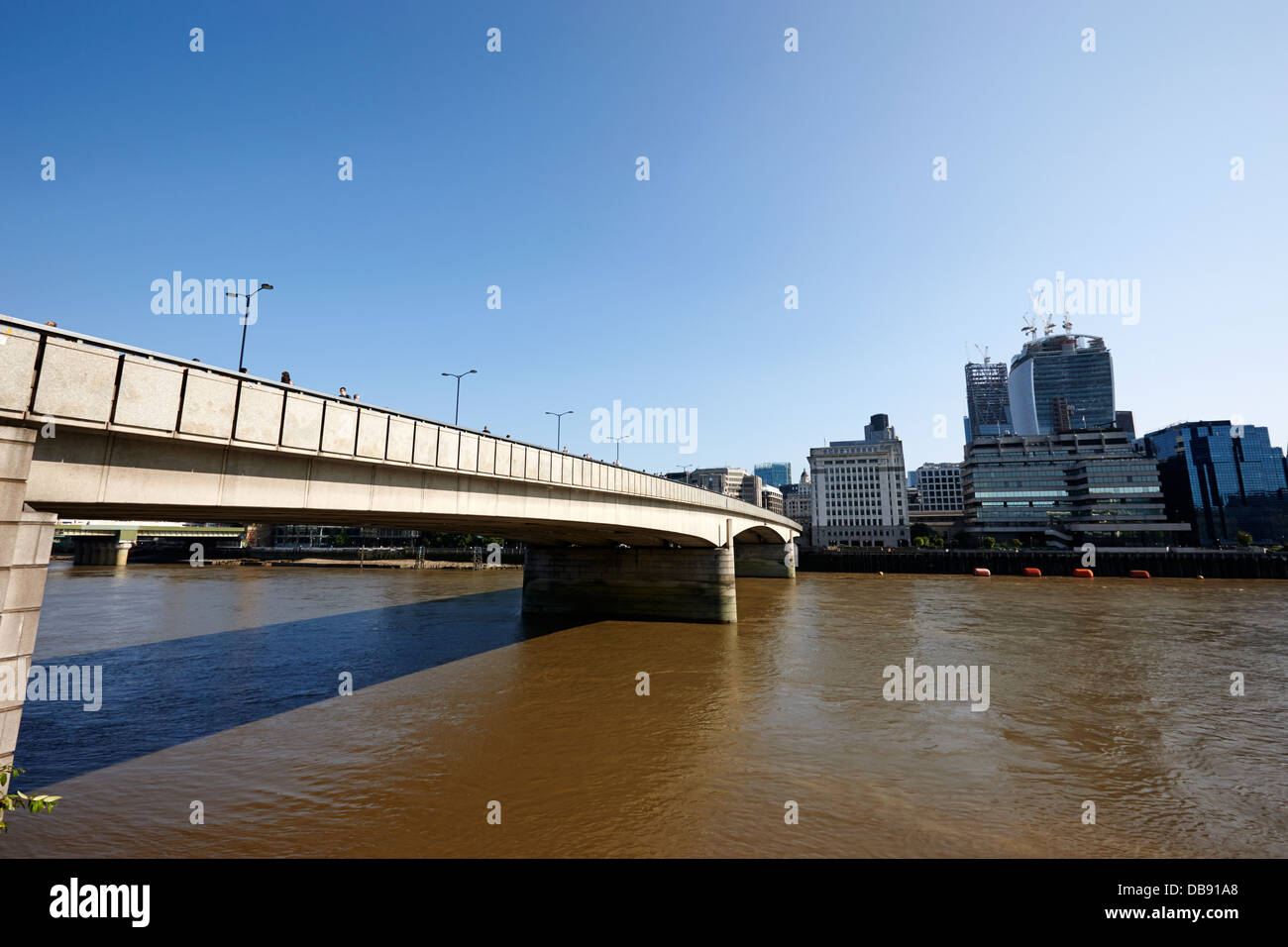 london bridge over the river thames leading to the city central London England UK Stock Photo