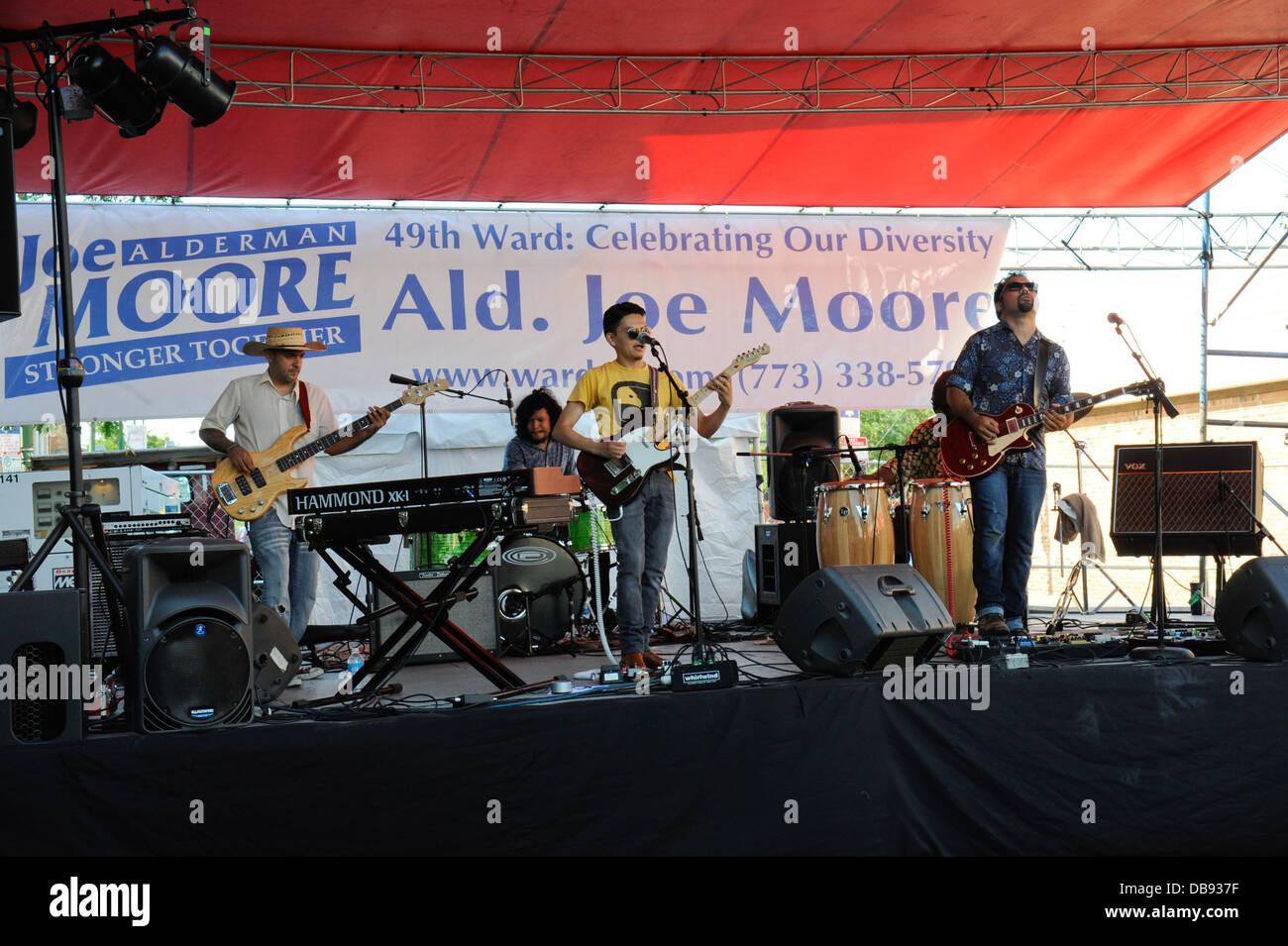 'Celebrate Clark St. Festival, Chicago, Illinois. 'Dos Santos Anti-Beat' cumbia band on stage. - Stock Image