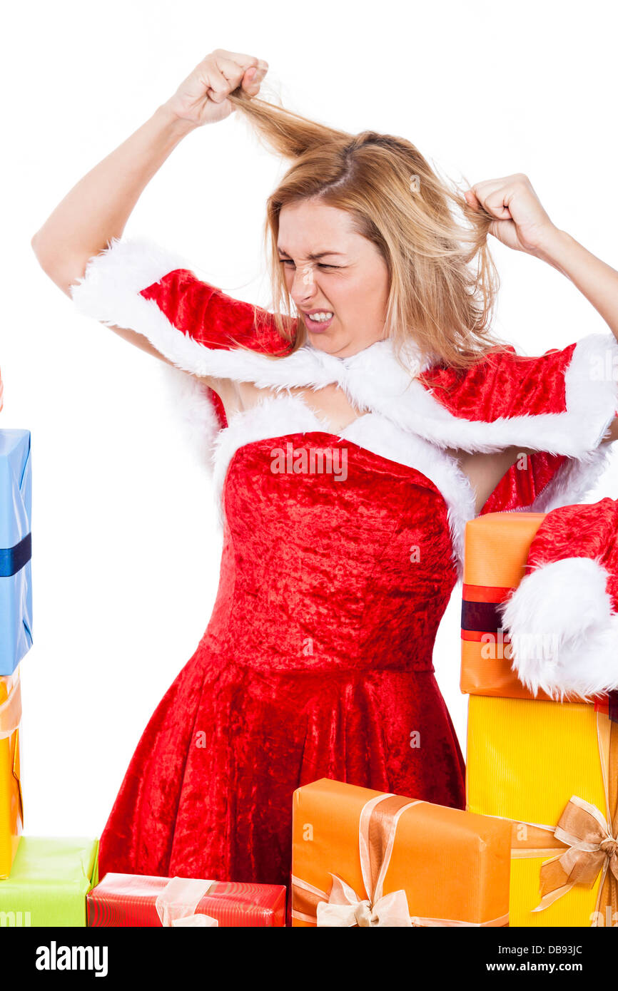 Mad Christmas woman in Santa costume, isolated on white background. - Stock Image