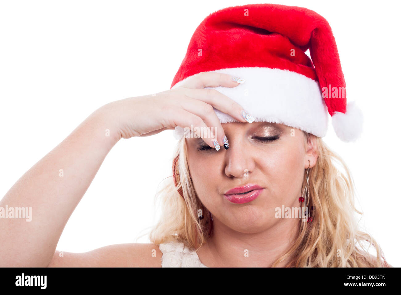 Stressed woman in Christmas hat, isolated on white background. - Stock Image