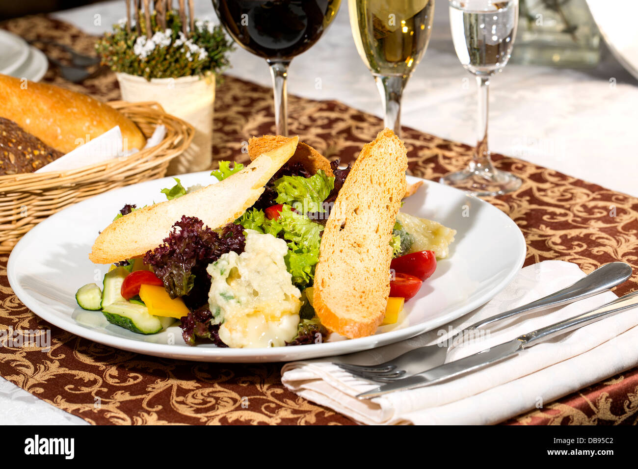 salad with cheese and meat on the table in a restaurant - Stock Image