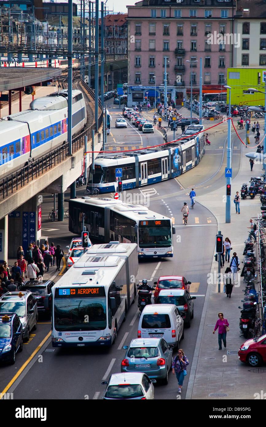 Train, buses, tram and general traffic at Geneva's Cornavin train station - Stock Image