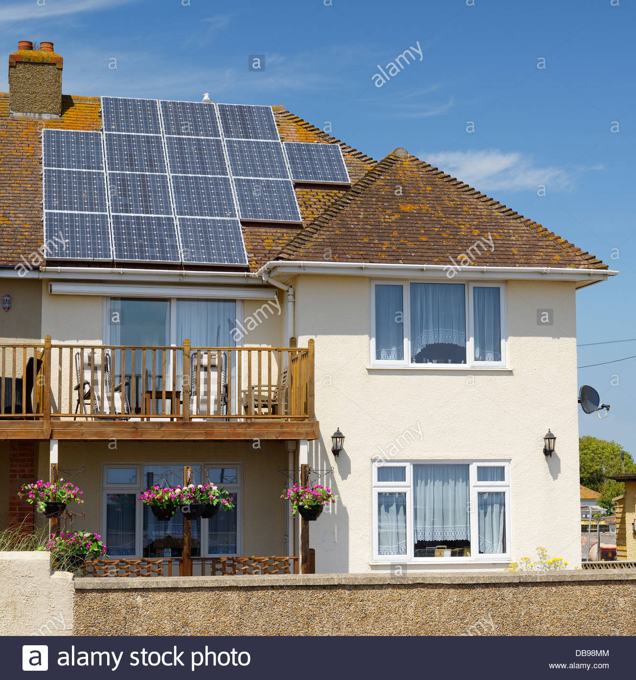 Solar panels on house roof, Seaton, Devon, England UK - Stock Image