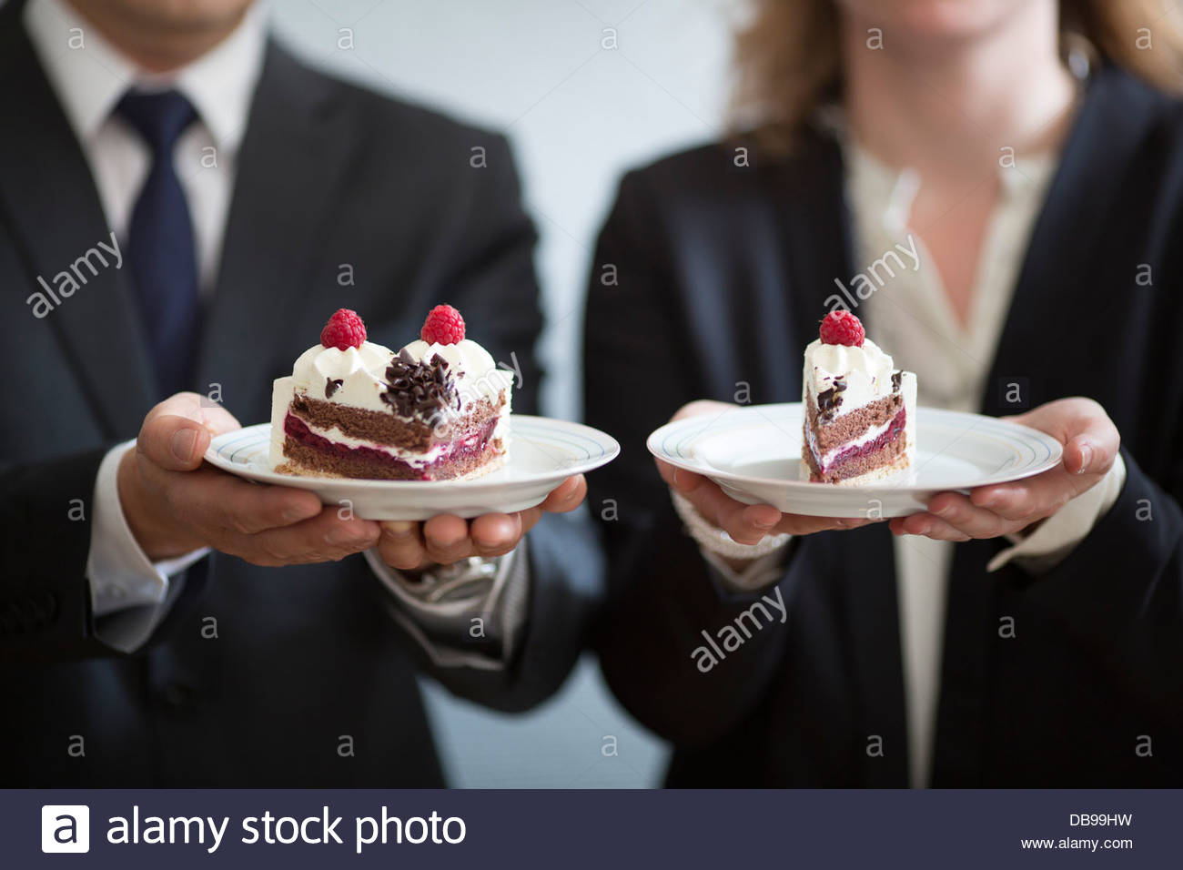 Business people holding plates of cake & Business people holding plates of cake Stock Photo: 58597445 - Alamy