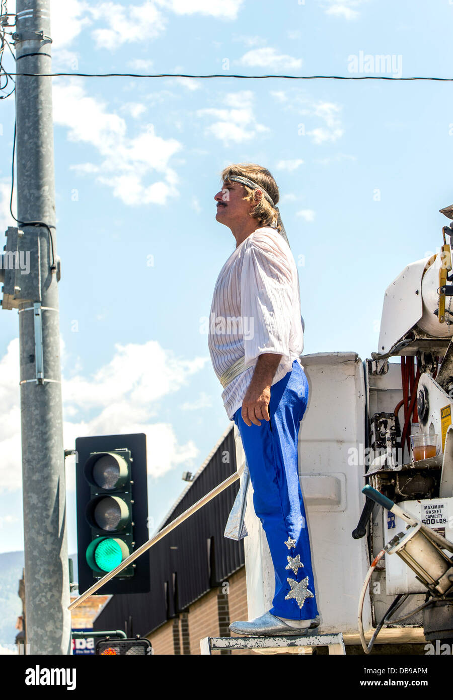 Butte, Montana, USA. 25th July, 2013. RICK WALLENDA prepares for his 700-foot, high wire walk up Main Street during - Stock Image