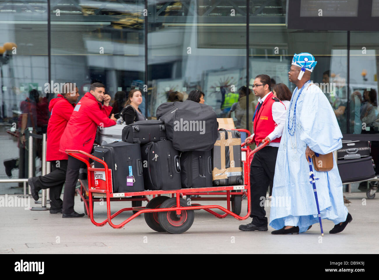 Porters at terminal two, Heathrow Airport, London, UK. - Stock Image