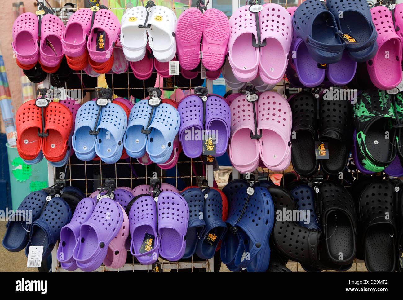 Plastic Croc shoes on display Cromer Norfolk England - Stock Image
