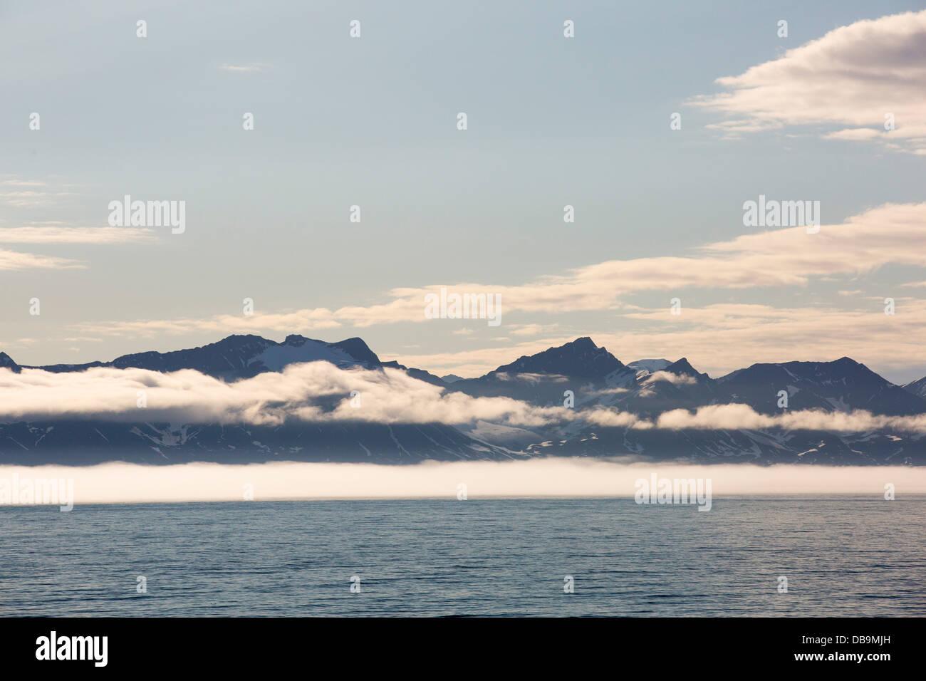 Coastal mountains on the side of Isfjorden on Spitsbergen, Svalbard, Arctic Ocean. Stock Photo