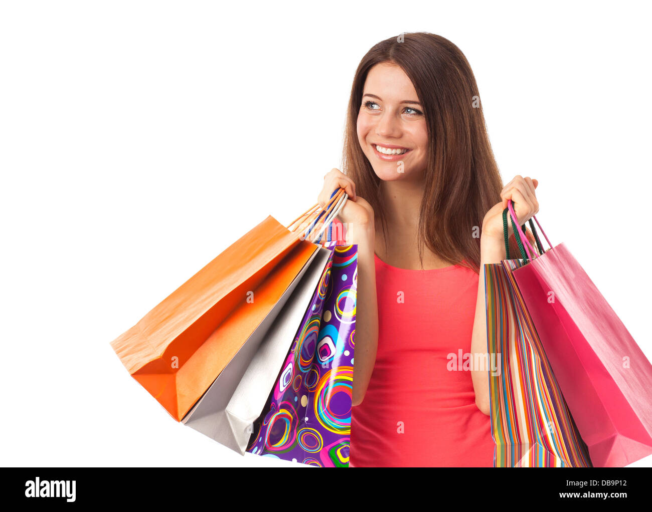 Young woman shopping and looking something, isolated on white - Stock Image