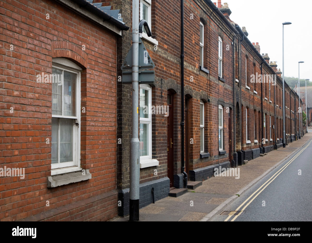 Row red brick terraced housing Cromer Norfolk England - Stock Image