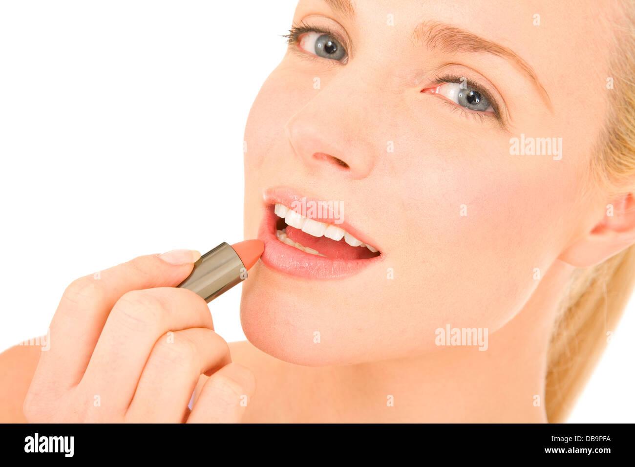 Woman applying lipstick - Stock Image