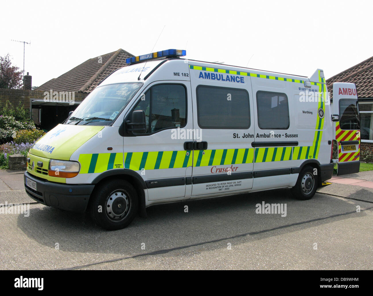 A St John Ambulance Service patient transport vehicle on call waiting for a patient to embark or collect - Stock Image