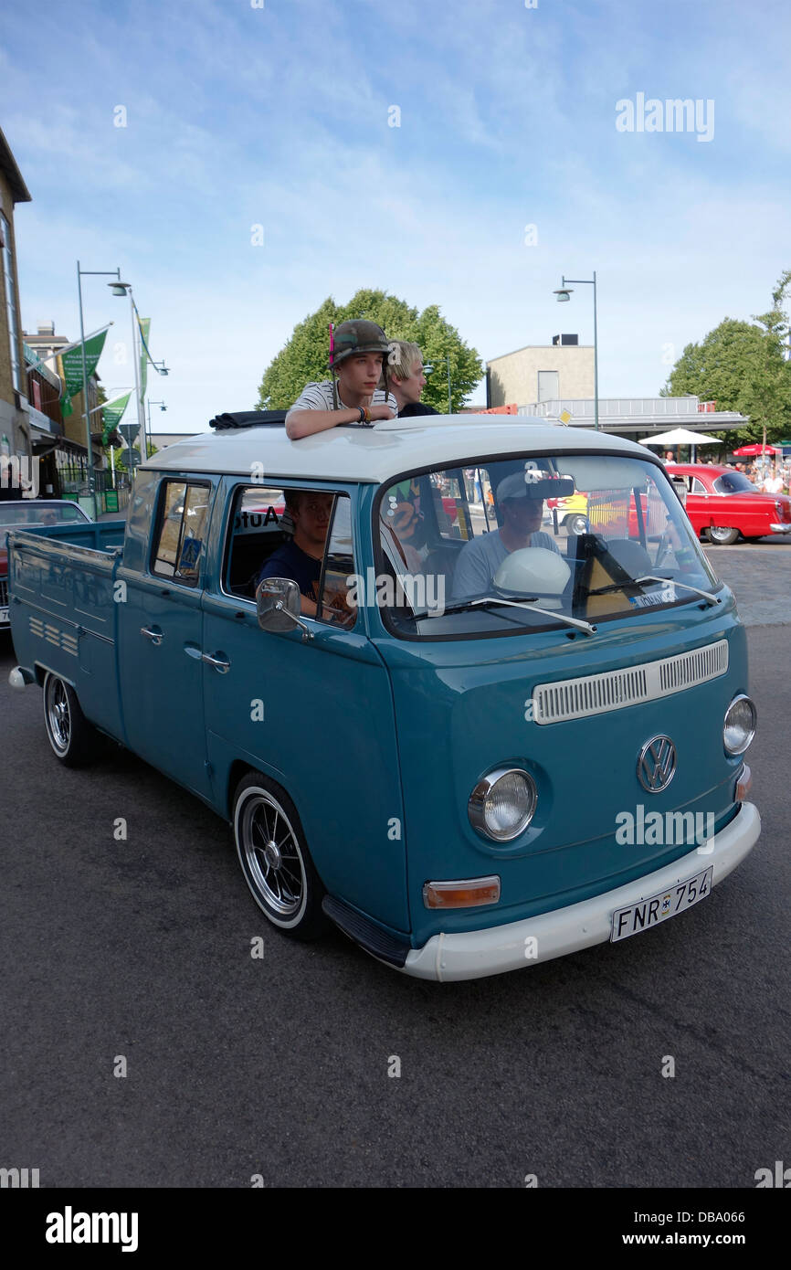 Boys on the ride with old VW Pick-Up 265 - Stock Image