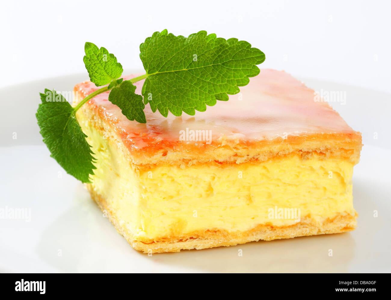Custard (Vanilla) Slice topped with sugar glaze - Stock Image
