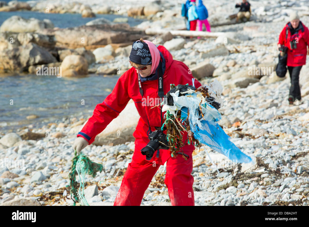 Tourist collect plastic rubbish on a remote beach in Northern Svalbard, only about 600 miles from the North Pole. - Stock Image