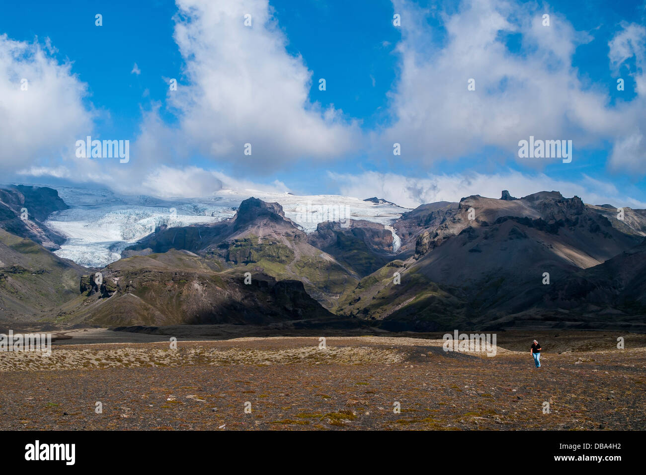 Tourists photographing the glacier tongues covering the Eyjafjallajökull volcano, which erupted in 2010. Iceland, - Stock Image