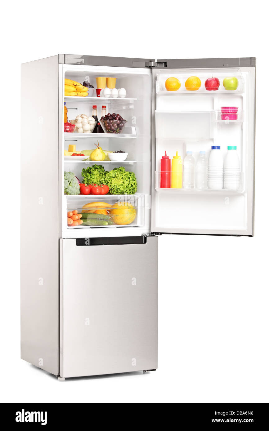 Open fridge full of healthy food products isolated against white background - Stock Image