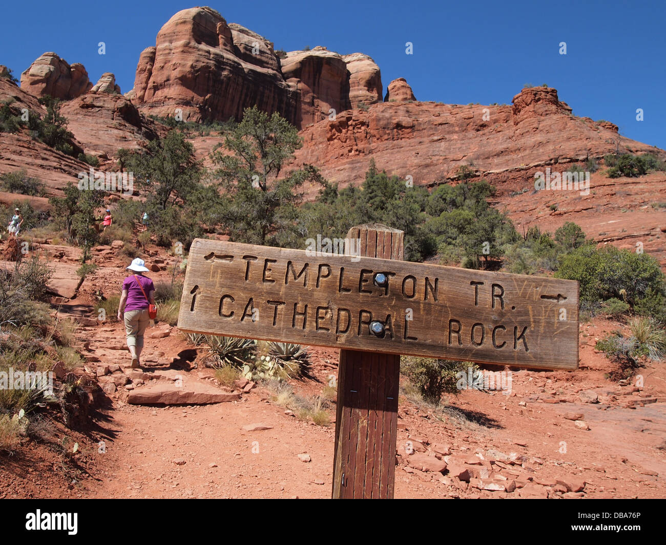 Tourists hiking at Cathedral Rock, a magnetic (feminine