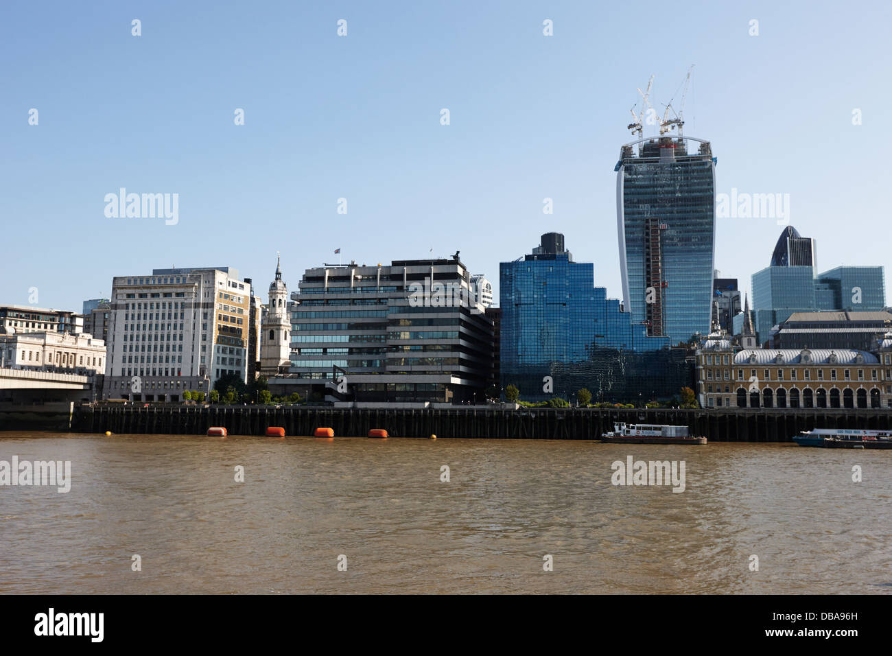 looking across the river thames at the city of London England UK Stock Photo