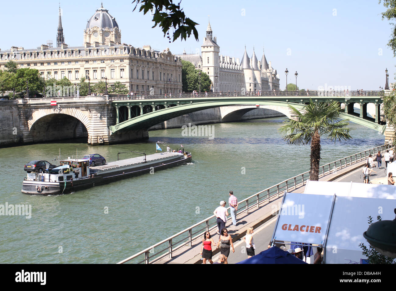 A boat on the river Seine approaching Pont Notre Dame in Paris, France. Looking South-West - Stock Image