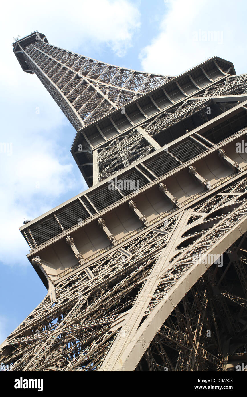 Obscure view from beneath Tour Eiffel (Eiffel Tower) - Stock Image