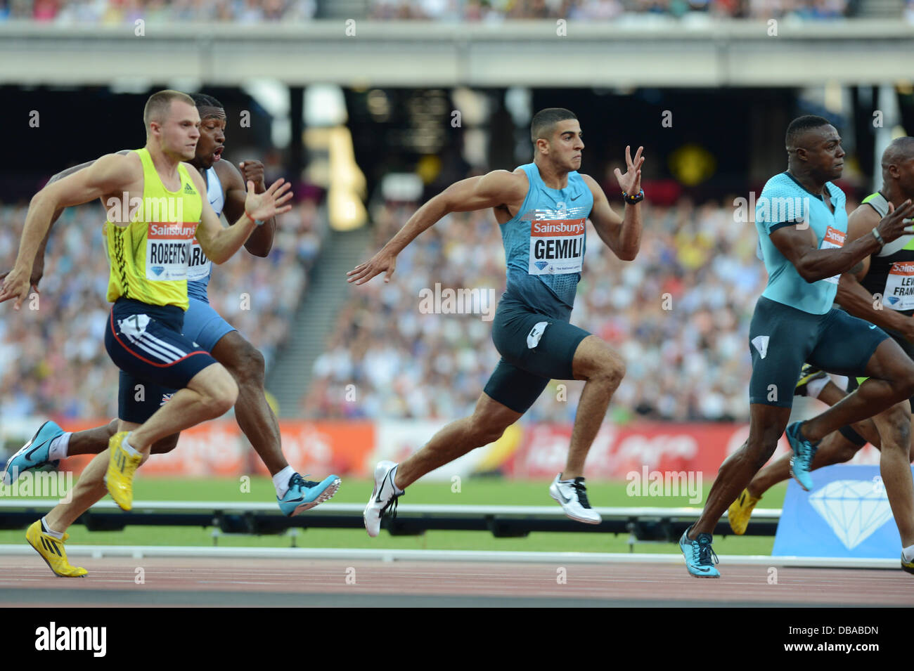 London, UK. 26th July, 2013. Adam Gemili races down Harry Aikines-Aryeetey and Mark Lewis-Francis in the men's - Stock Image