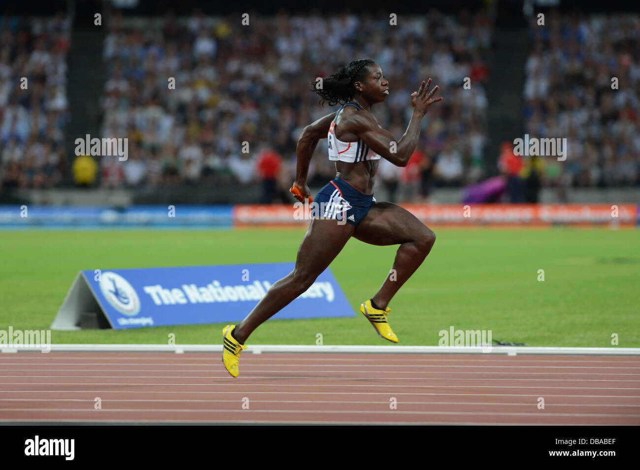London, UK. 26th July, 2013. Anyika Onuora helps the GB women's 4 x 100m team to victory at the London Anniversary - Stock Image