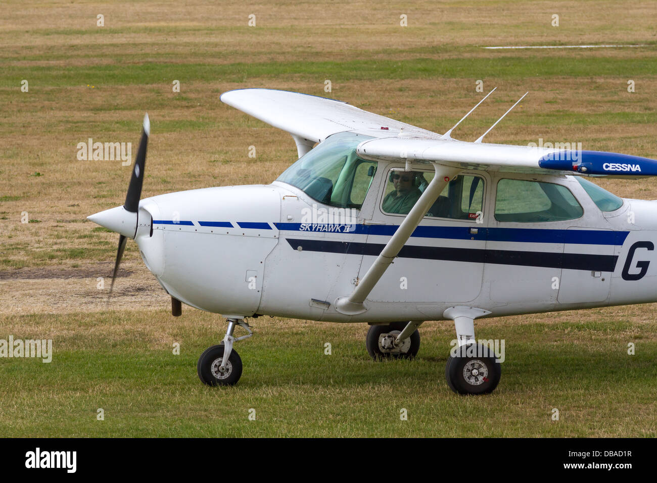 Cessna Light Aircraft taxiing on Airfield at City Airport formerly Barton Aerodrome - Stock Image