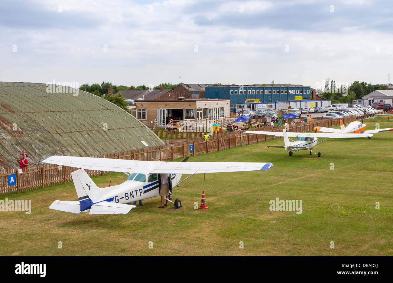 Light aircraft parked on airfield at City Airport formerly Barton Aerodrome in Eccles, Manchester - Stock Image