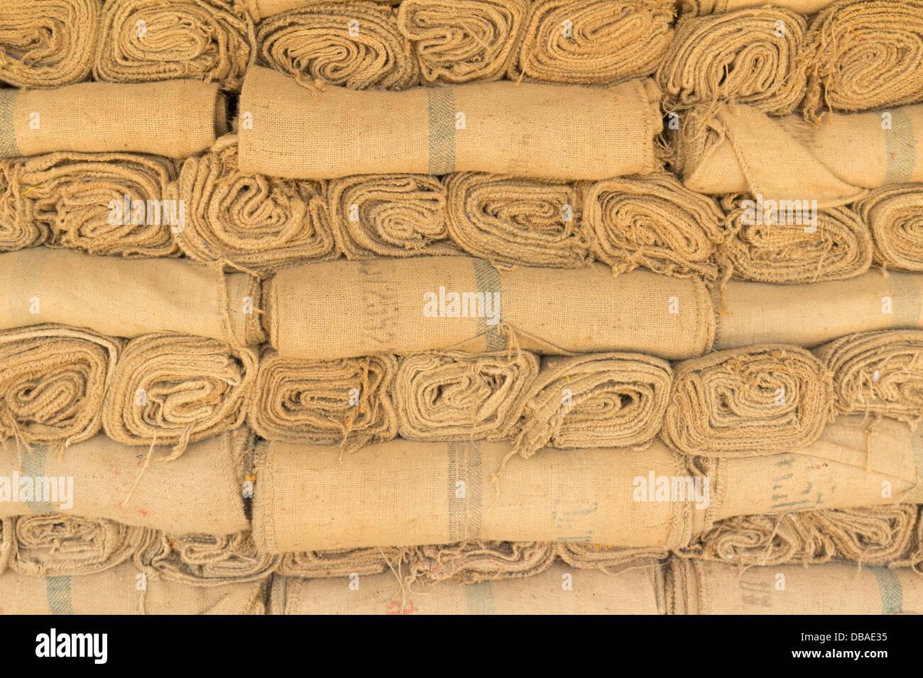 Hemp sacks in a row set unavailable - Stock Image