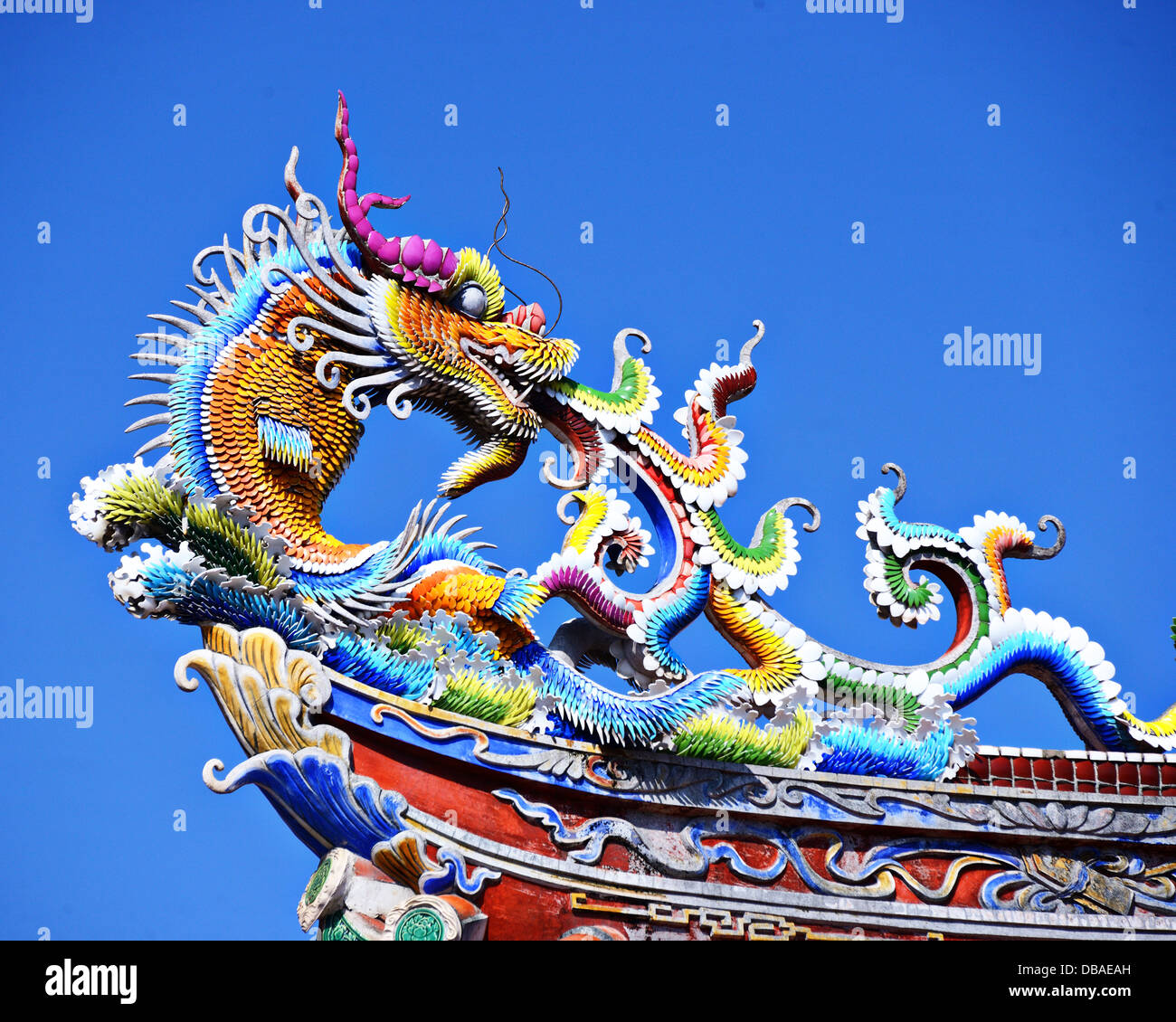 Ornate Chinese Temple detail in the sky. - Stock Image