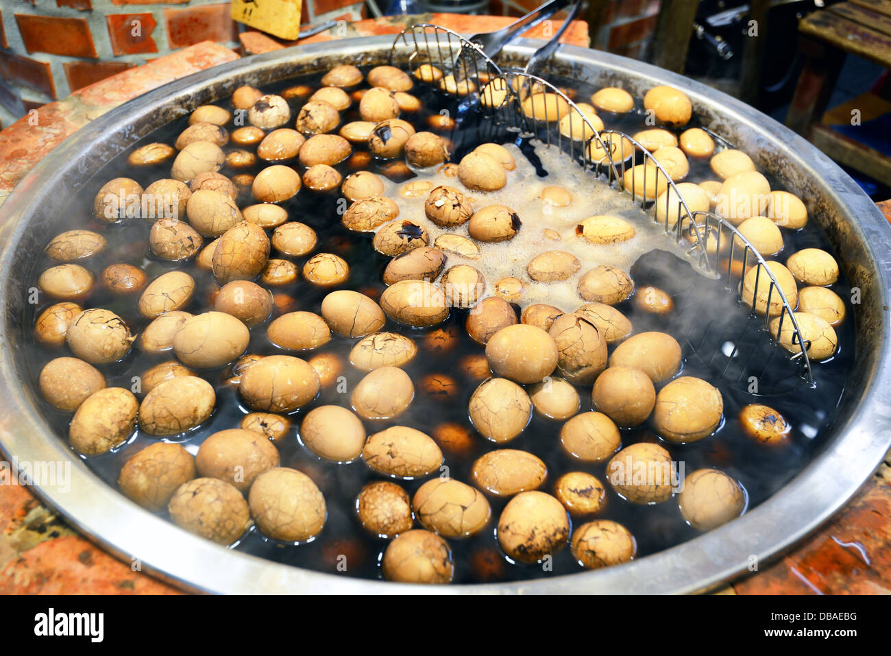 Eggs boiling in a market in Jiufen, Taiwan. - Stock Image