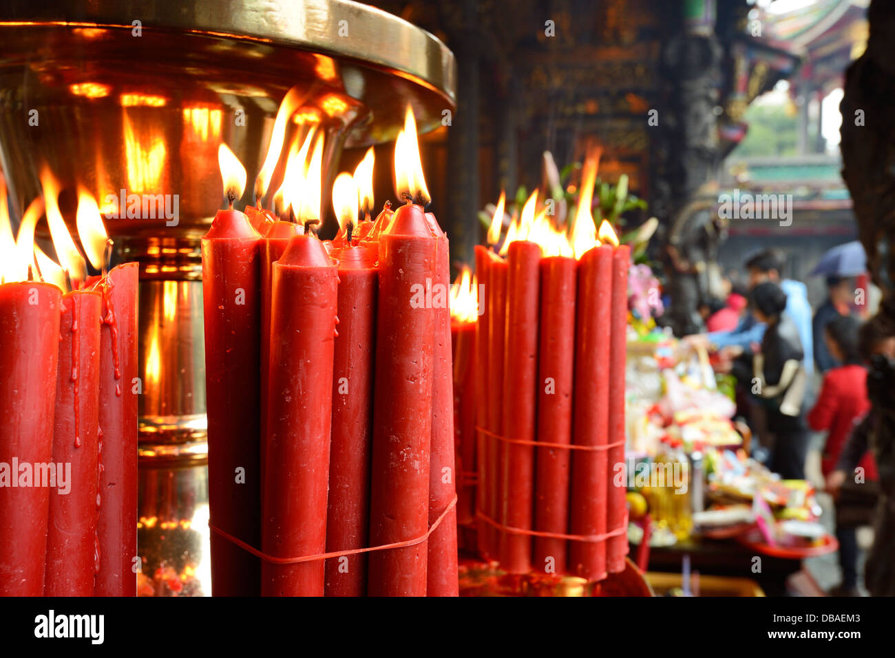 Candles at Longshan Temple in Taipei, Taiwan. - Stock Image