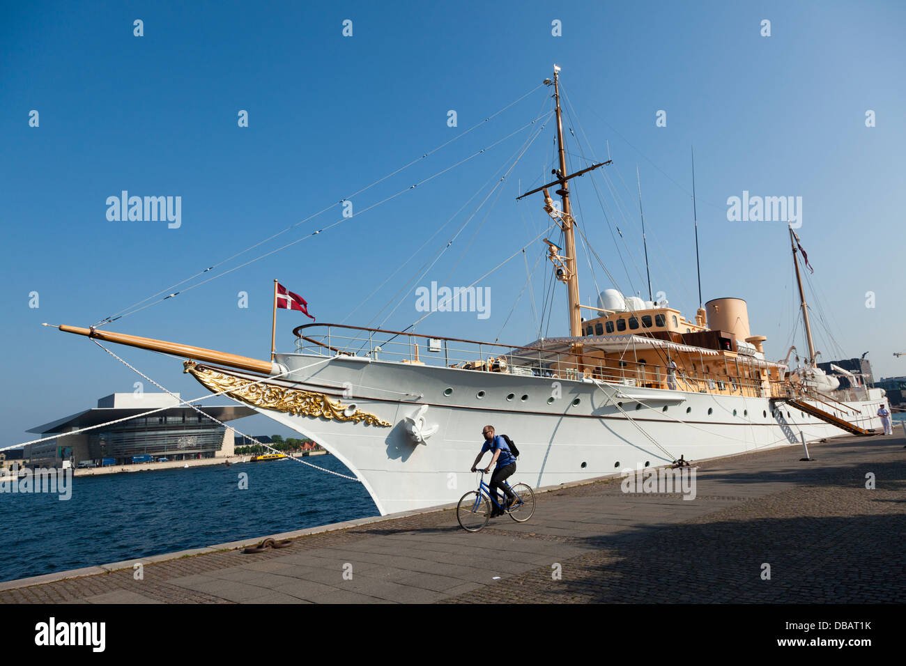 Cyclist in front of Royal yacht in Copenhagen - Stock Image