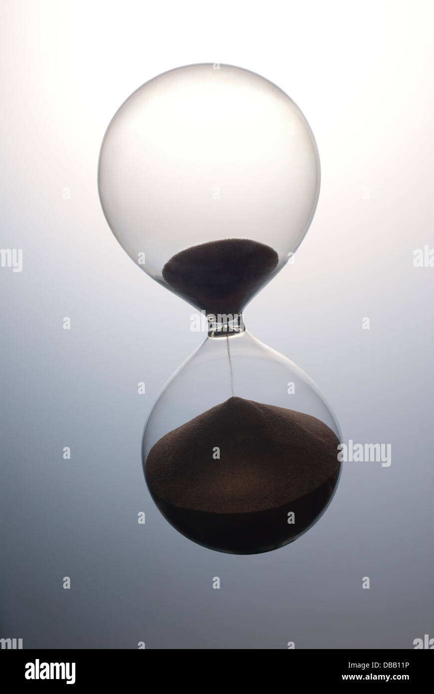 Hour glass sand timer running out of time - Stock Image