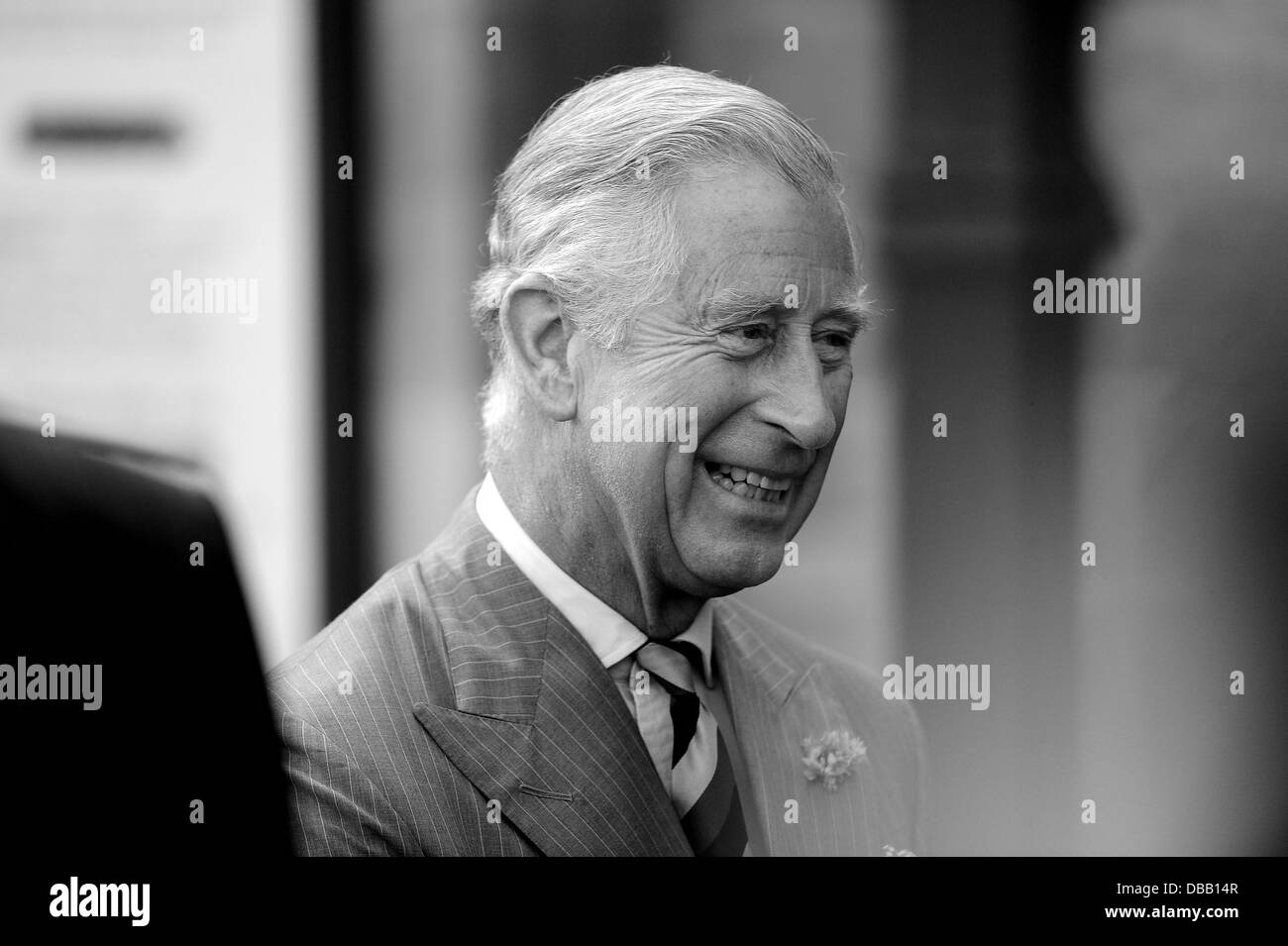 HRH The Prince of Wales, Prince Charles visits Kemble railway station in Gloucestershire to open a garden. - Stock Image