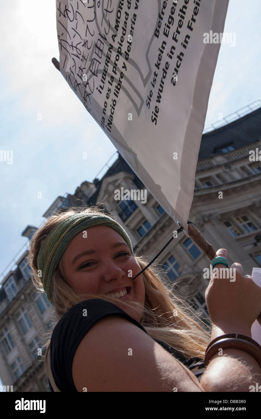London, UK. 27th July 2013. An anti-cruelty protester holds her end of a banner as protesters in London and around Stock Photo