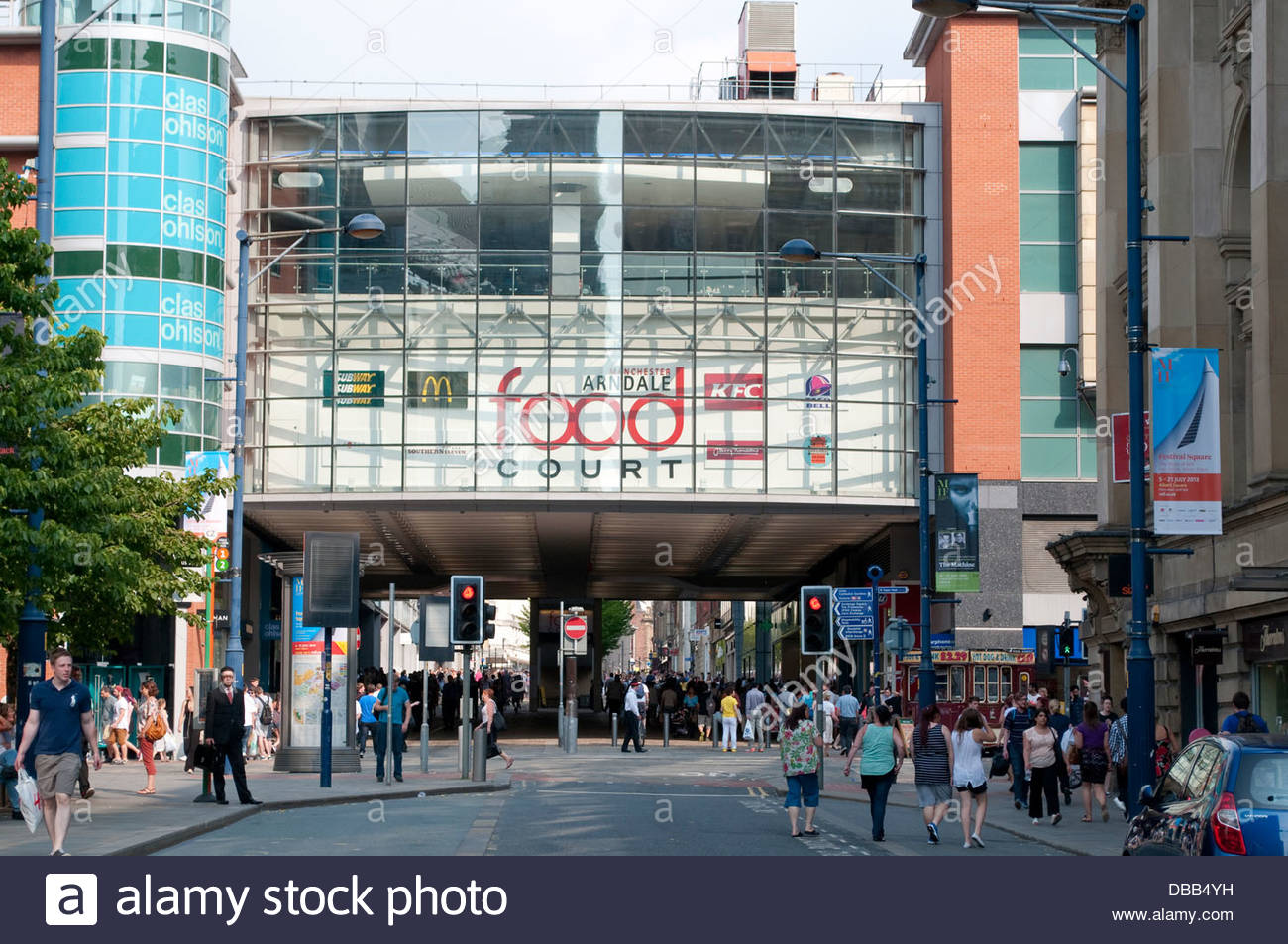 Shops and people at Exchange Square, Manchester, UK - Stock Image