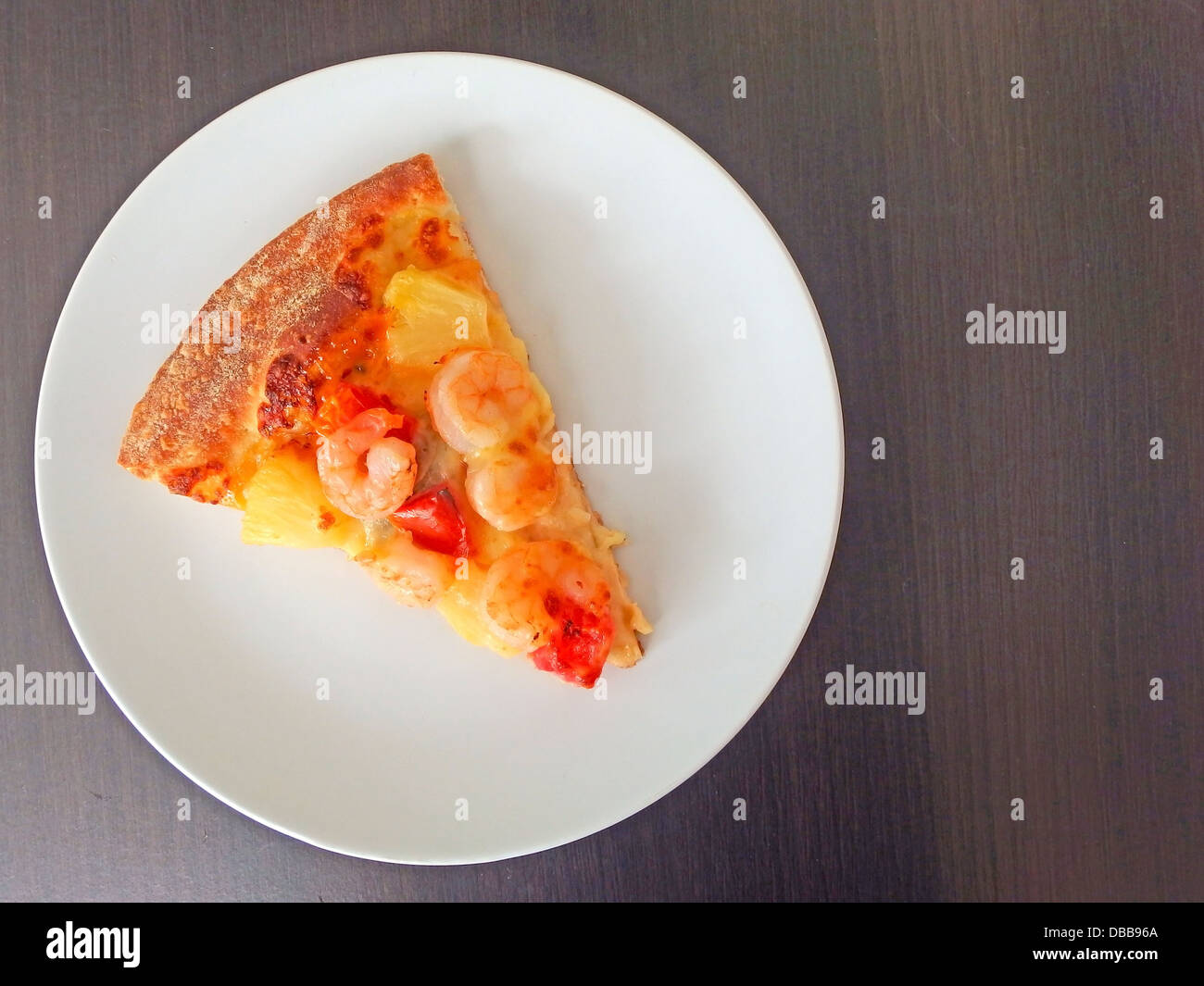 Cut off slice pizza on white dish - Stock Image